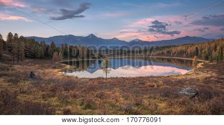 Mirror Surface Lake Early Sunset Wide Angle Autumn Landscape With Mountain Range On Background. Wild Nature Forest Water Scenery Photo With Calm Atmosphere Image.