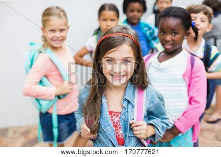 Group of kids wearing school bag standing on school terrace