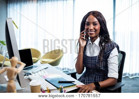 Businesswoman on the phone in the office