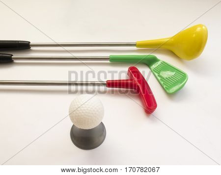 Three Golf Clubs - Wood, Putter, Iron And A Ball