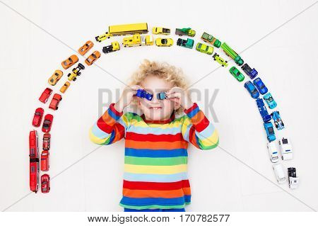 Little Boy Playing With Toy Cars. Toys For Kids.