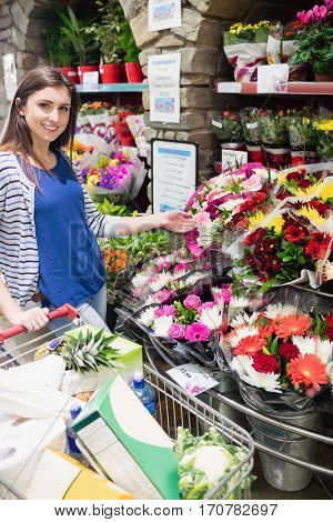 Woman choosing flowers in a shop