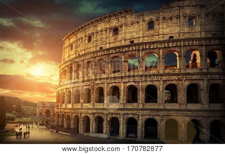 Rome, Italy.One of the most popular travel  place in world - Roman Coliseum under evening sun light and sunrise sky.