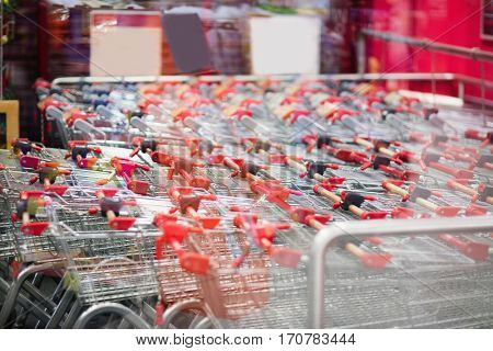 View of trolleys gathering together in front of a supermarket