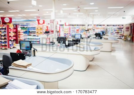 View of tills and shelves in the supermarket