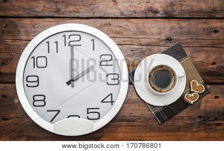 Coffee time: cup of coffee and wall clock