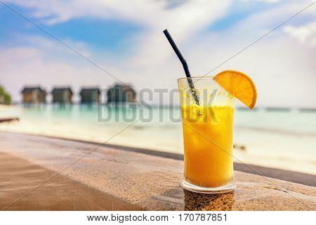 Fresh orange juice by the poolside. Tropical island resort in Maldives, Indian Ocean