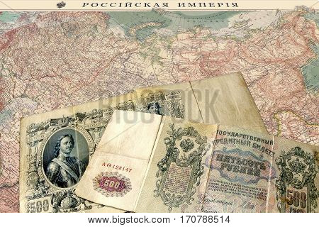 photography with scene of the banknotes to russian empire sample 1912 on background of the geographical map