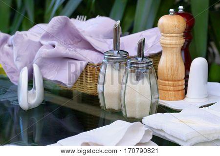 sugar bowl on a glassen table