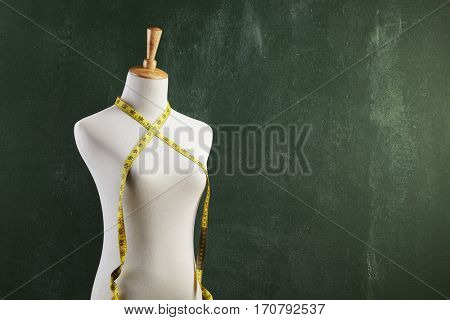 Female mannequin with measuring tape