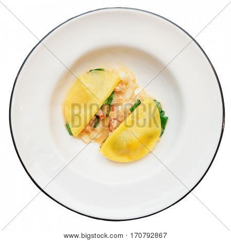 Ravioli-like dish with crayfish, apples and herbs isolated on white background