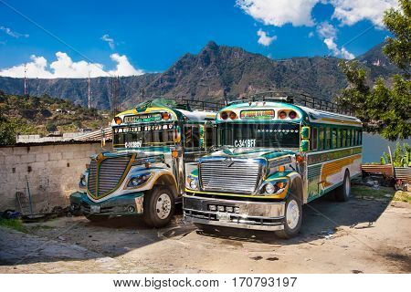 SAN PEDRO,GUATEMALA -DEC 24, 2015: Typical chicken bus in San Pedro on Dec 24, 2015. Guatemala. Chicken bus It's a name for colorful, modified and decorated bus in various latin American countries