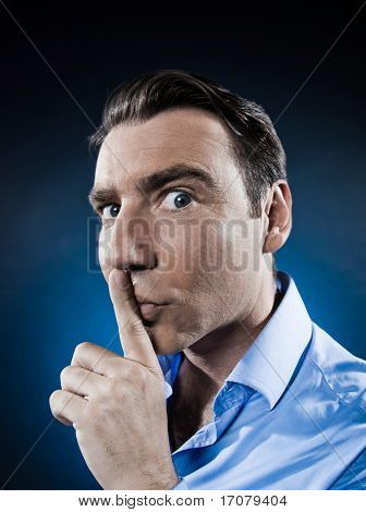 caucasian man hush sign portrait isolated studio on black background