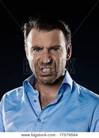 caucasian man unshaven pucker anger portrait isolated studio on black background