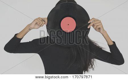 Woman Vinyl Record Covering Face Studio Portrait Concept