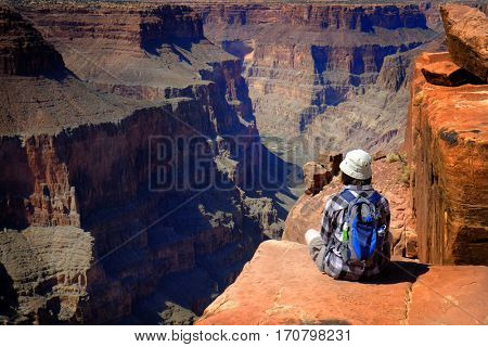 People at the North Rim of the Grand Canyon looking out