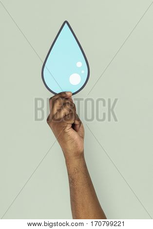 Human Hand Holding Water Droplet