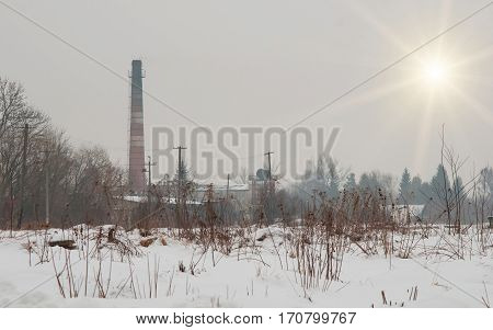 brick factory chimney. Tube for propulsion bricks in the furnace. Pipe on a background sunset