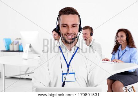Young male technical support dispatcher working in office, closeup