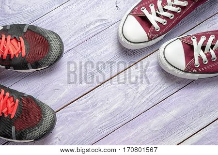 two pair of gumshoes on a wooden background with copy space