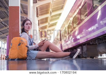 Tourists siting with train travel,sunlight yellow color