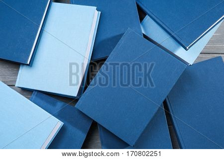 Blue hardcover books background