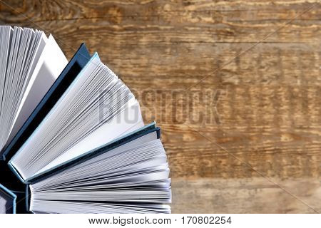 Hardcover books on wooden background