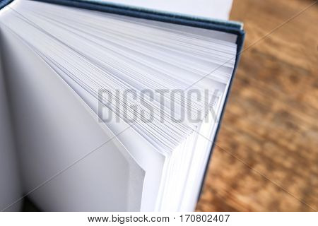 Hardcover books on wooden background, closeup