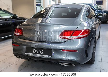 GDANSK, POLAND - JANUARY 30, 2017: Brand new 2017 model of Mercedes C-klasse coupe in the car showroom of Gdansk, Poland. Mercedes-Benz is German luxury  automobile manufacturer located in Stuttgart.