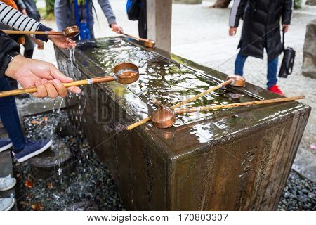 Water purification at entrance of the Japanese temple