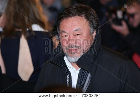 Ai Weiwei poses on the red carpet during opening ceremony of the 67th Berlinale International Film Festival at Grand Hyatt Hotel in Berlin, Germany on February 9, 2017.