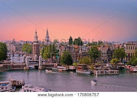 City scenic from Amsterdam in the Netherlands at sunset