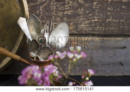 A set of antique cutlery on a wooden background