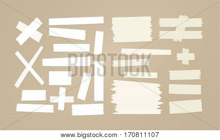 Brown and white sticky paper, adhesive, masking tape stuck on brown background.