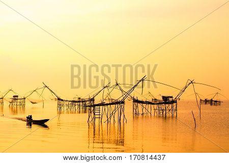 Landscape of square dip net or Yo(Thai language)made of bamboo in morning at Ban Pak Pra -Talay Noi Lake, Phatthalung, Thailand.