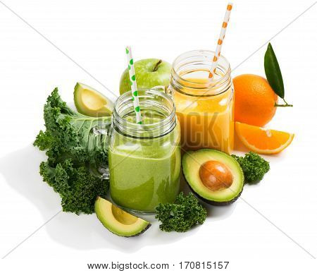Fruity and vegetable smoothies with ingredient ( kale avocado apple and orange) isolated on white background.