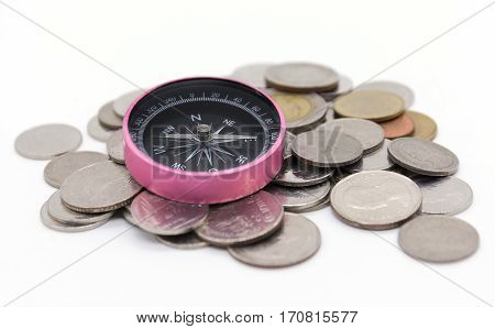 compass and coins on white background on white background