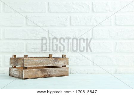 Wooden Crate On The Brick Wall Background