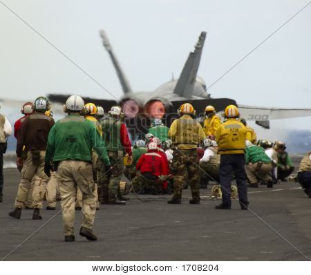 Group Of Sailors At Work On Flight Deck