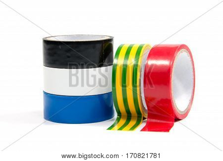 Closeup of multicolored insulating tapes isolated on white background