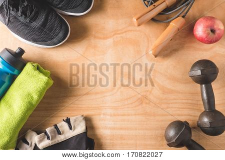 Top view of Sport stuff on wooden table background Fitness lifestyle concept Free space for text