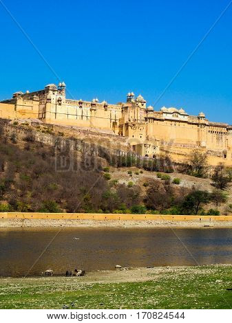 A view of the Amber Fort overlooking a pond in Jaipur India.