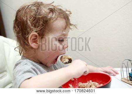 Child Eating Porridge