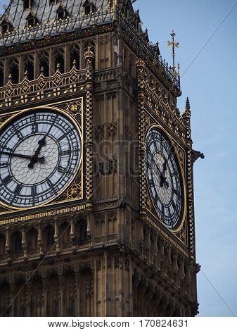 A detail of the ornate Big Ben clock on the parliament building in London England.
