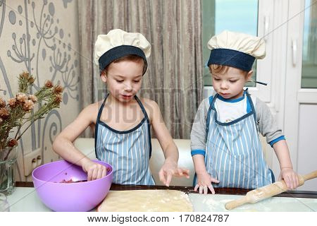 Two Children Mold Dumplings