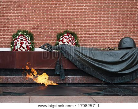A memorial eternal flame at the tomb of the unknown soldier outside the Kremlin wall in Moscow Russia.