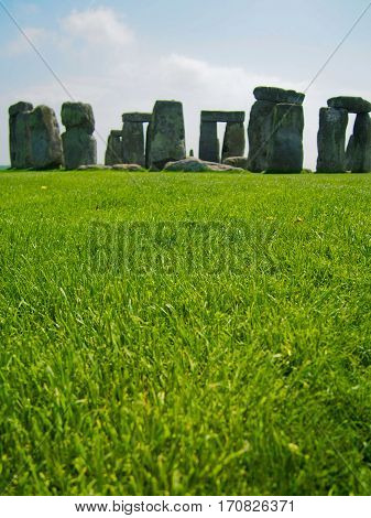 Ancient ruins of Stonehenge in English countryside on a sunny day.