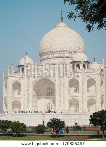 The bright white marble Taj Mahal building in Agra India.