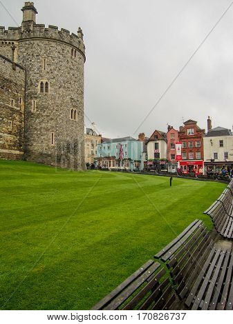 Medieval Windsor Castle in the quaint town of Windsor near London England.