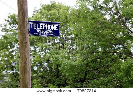 Dorset, Uk - May 31St 2016: Vintage British Telephone And Telegram Sign On A Traditional Wooden Pole